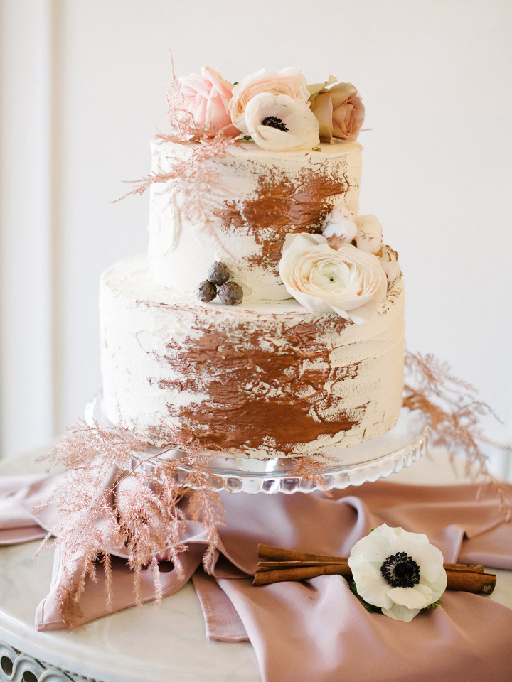 winter wedding cake with floral accents