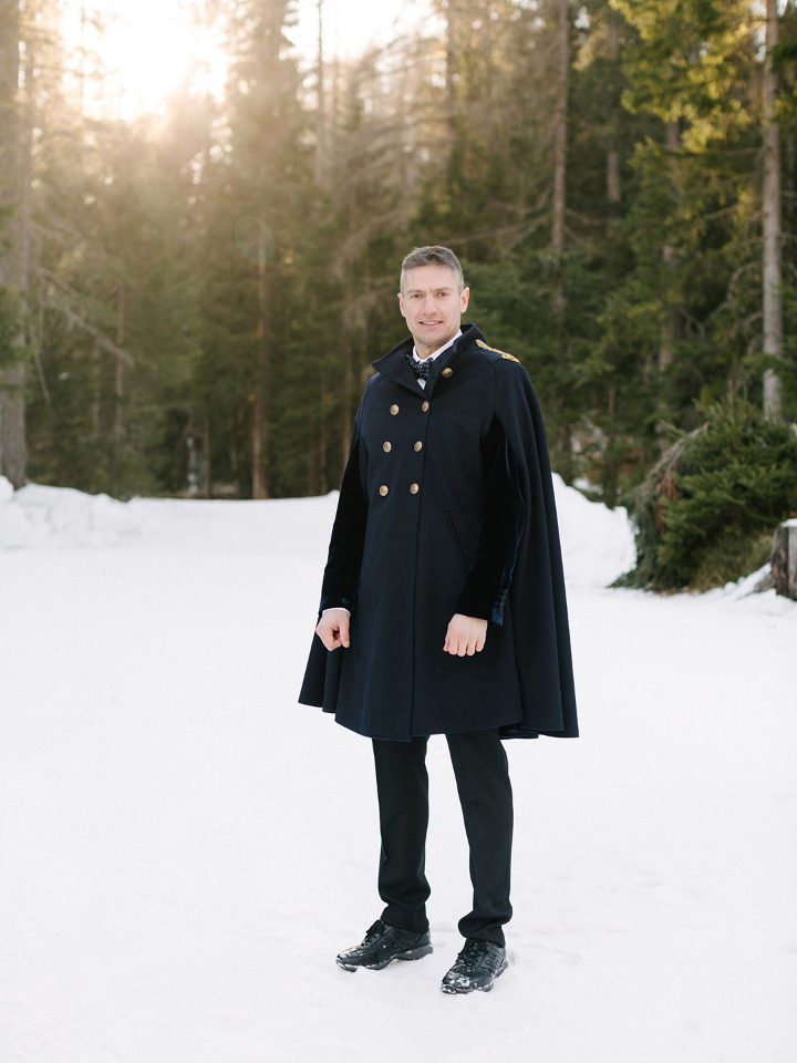 groom attire with cape coat for winter wedding