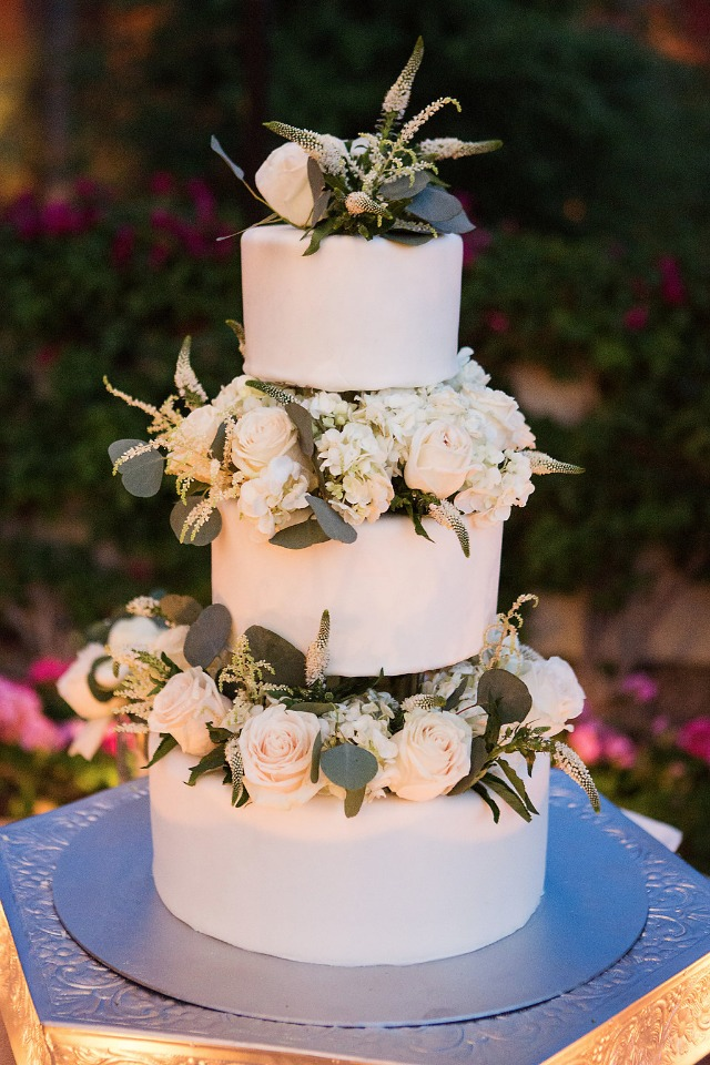 wedding cake with a side of flowers