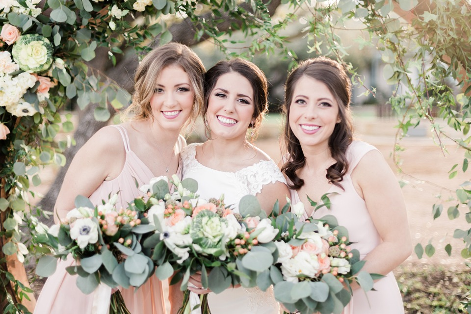 bride and her bridesmaids in soft peach