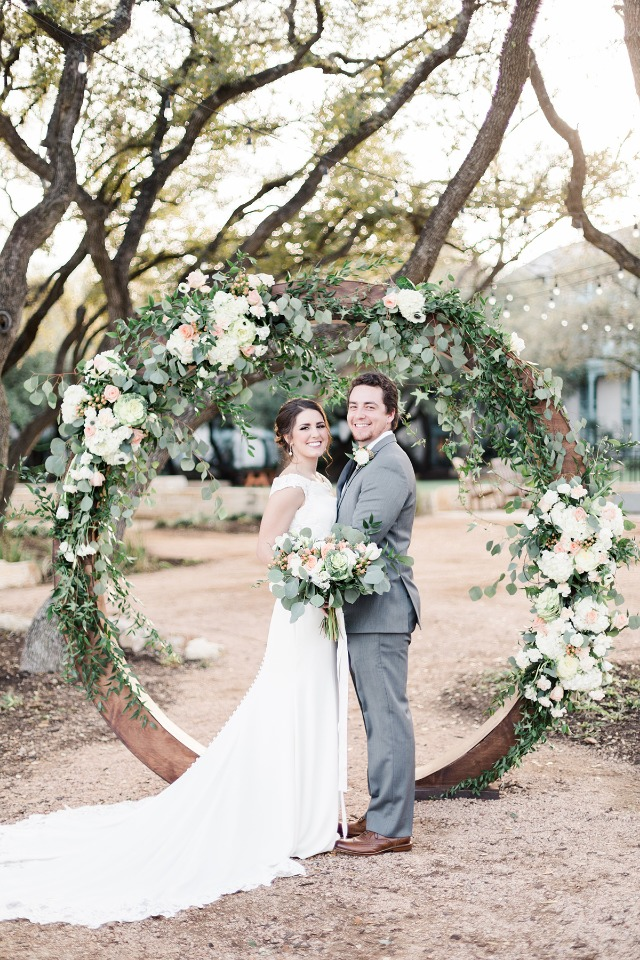 flower covered circle wedding arch backdrop