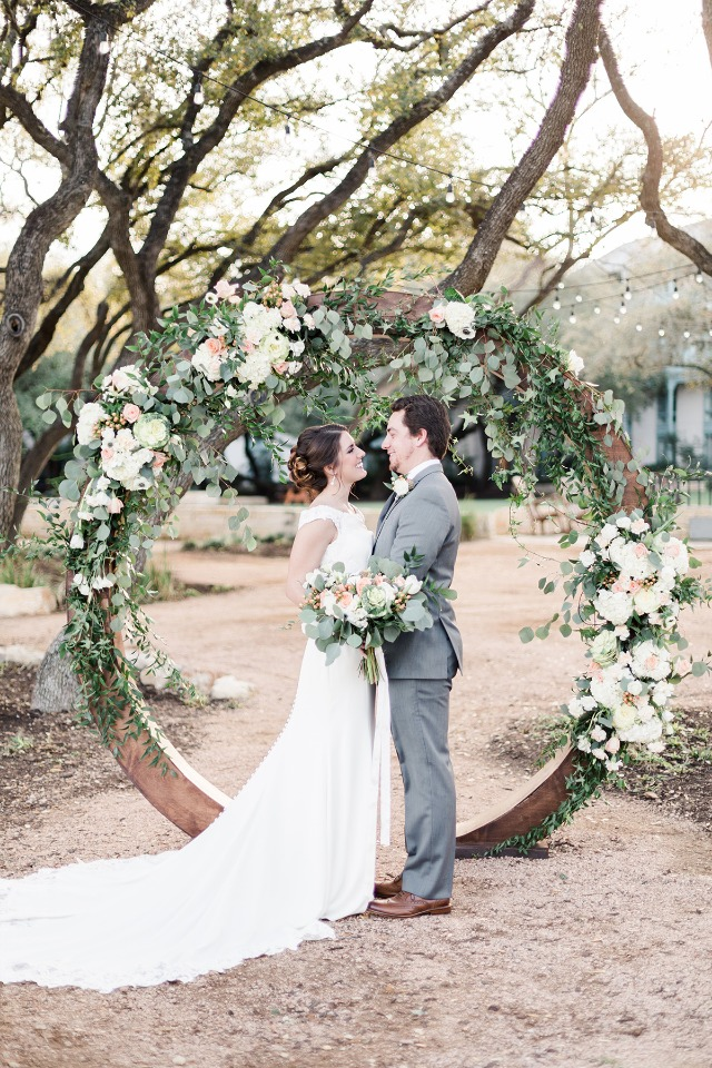 circular wedding arch with floral garland