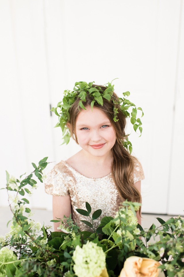 cute little flower girl with greenery halo and gold sequin dress