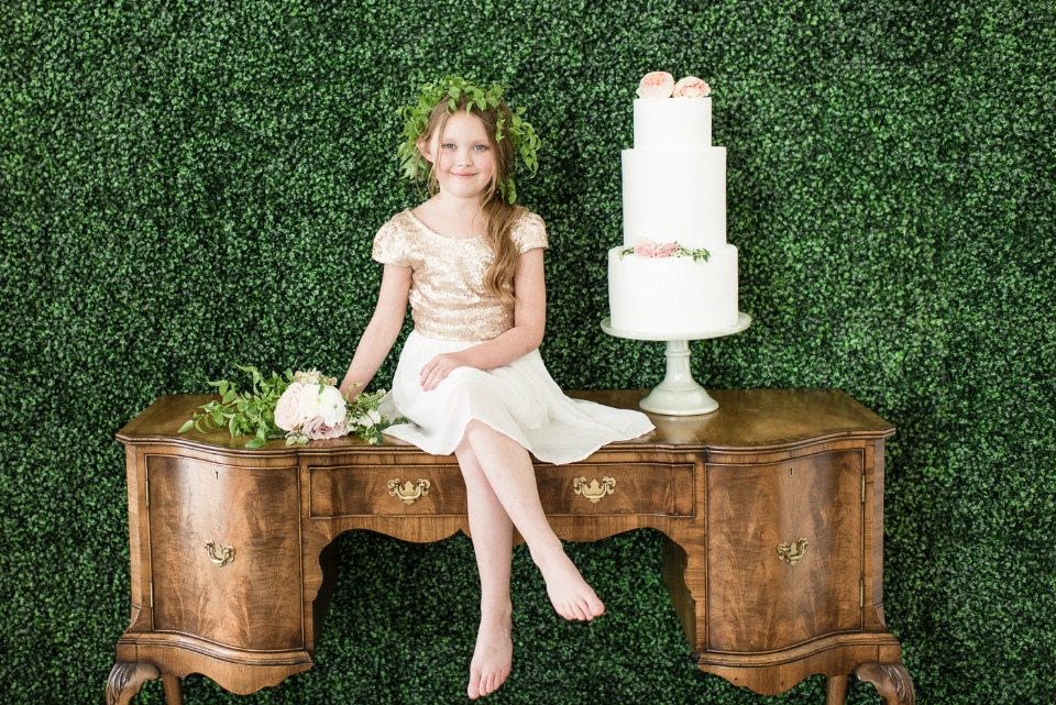 vintage cake table with greenery wall