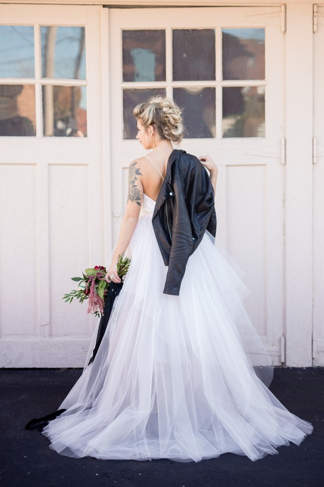 Love this strappy tulle dress and leather jacket combo