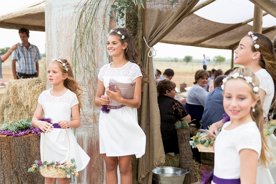 flower girls welcoming you to the tent chapel