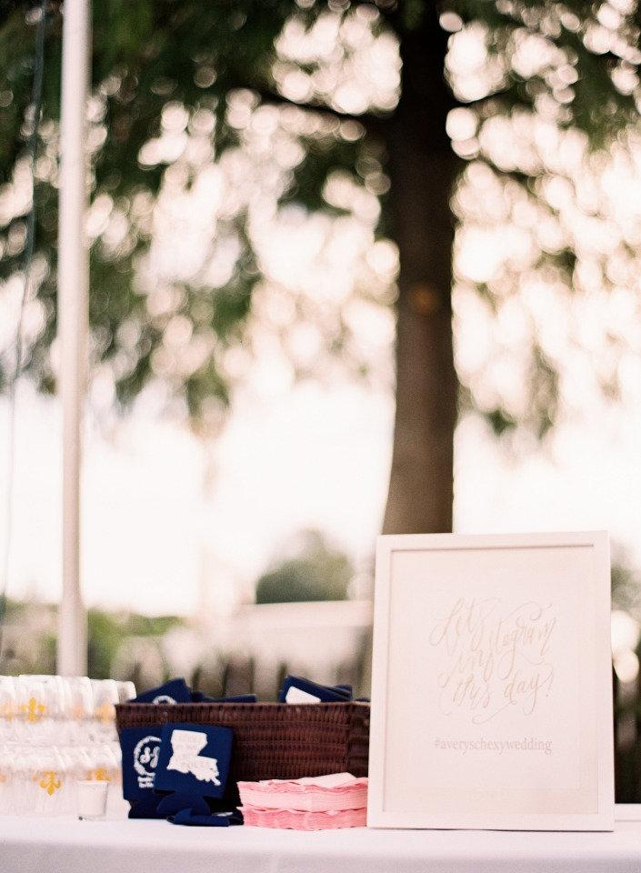 Welcome table with koozie favors