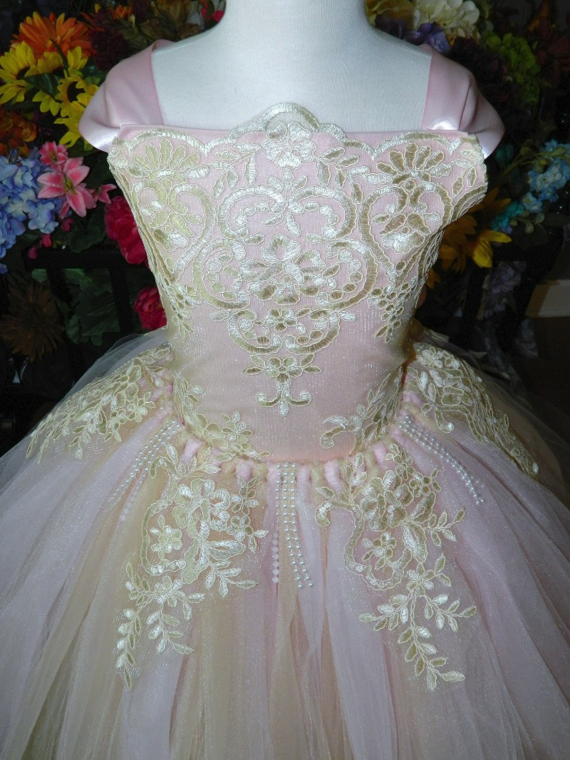 Blush pink and ivory make this stunning flower girl dress perfect for any spring wedding...