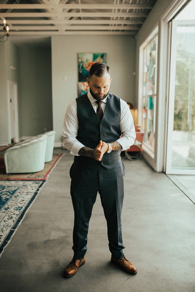groom in suit vest and pants