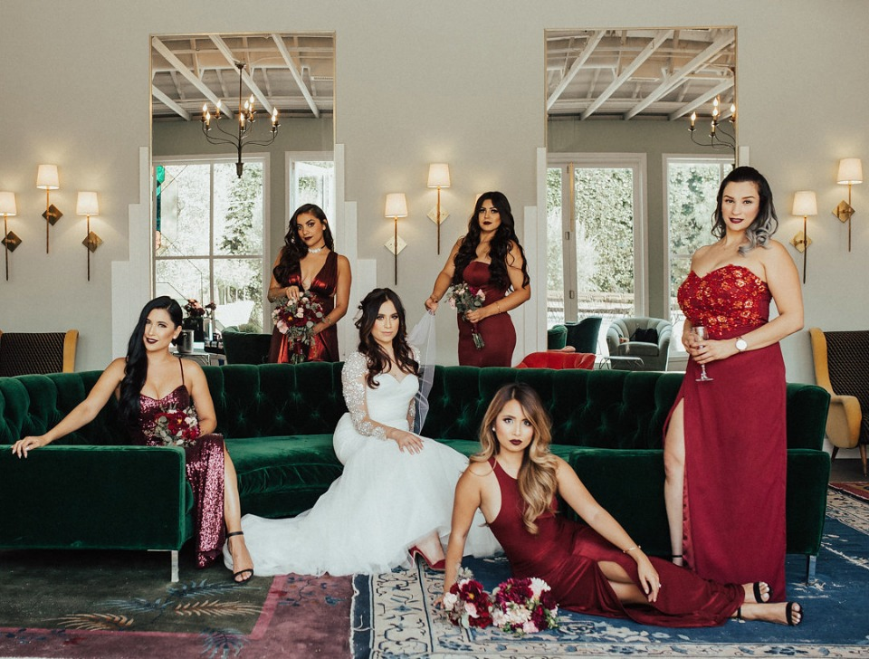 bride and bridesmaids in candy apple red