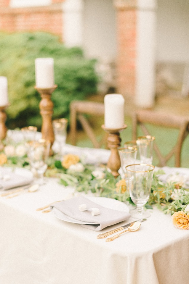 Gold flatware and pillar candles