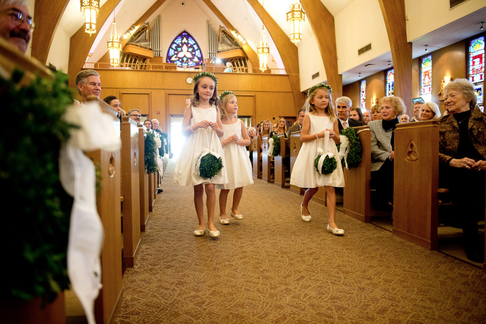 adorable flower girls with kiss balls