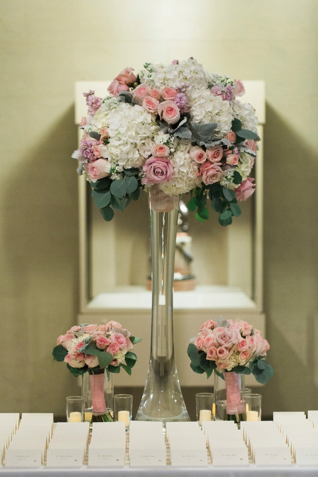 pink and white floral decor for the escort card table
