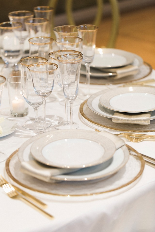 formal dinner reception table decor in gold and white