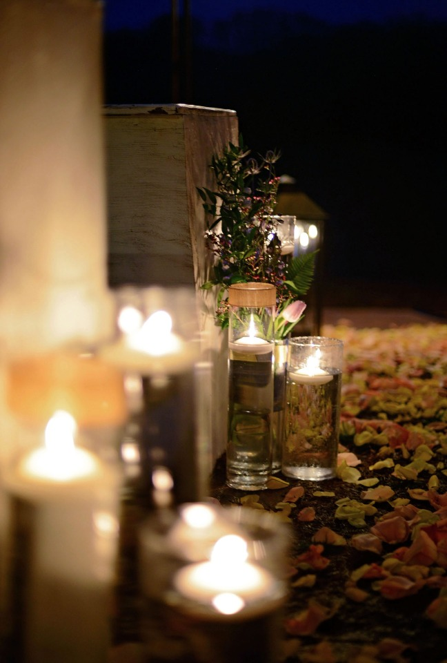 glowing candle lit and floating candle aisle decor