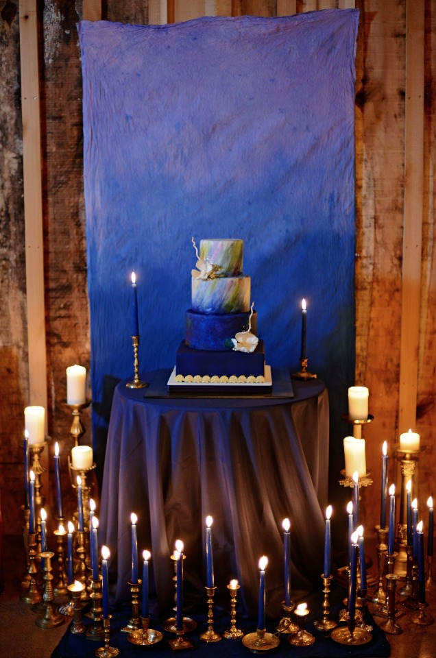 night time wedding cake and candle lit table