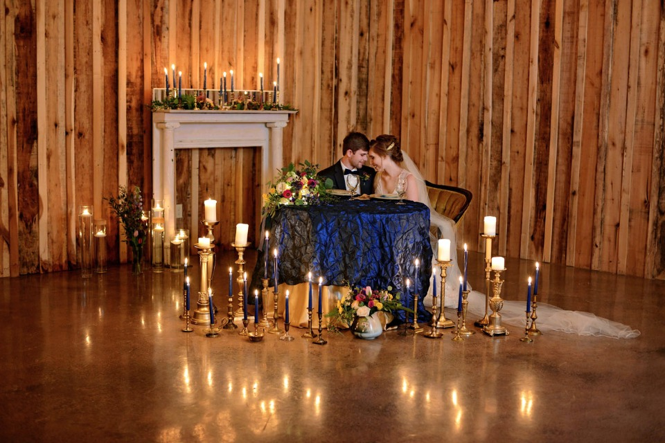 sweetheart table surrounded by candles