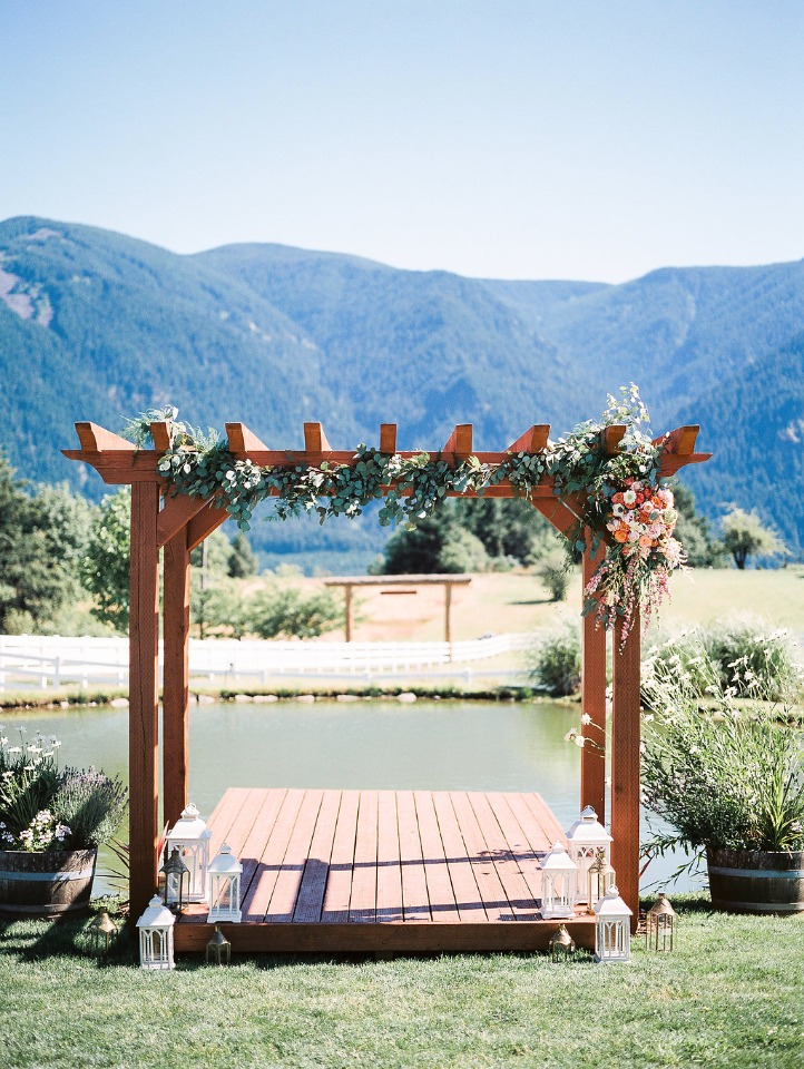 Ceremony pergola covered in flowers