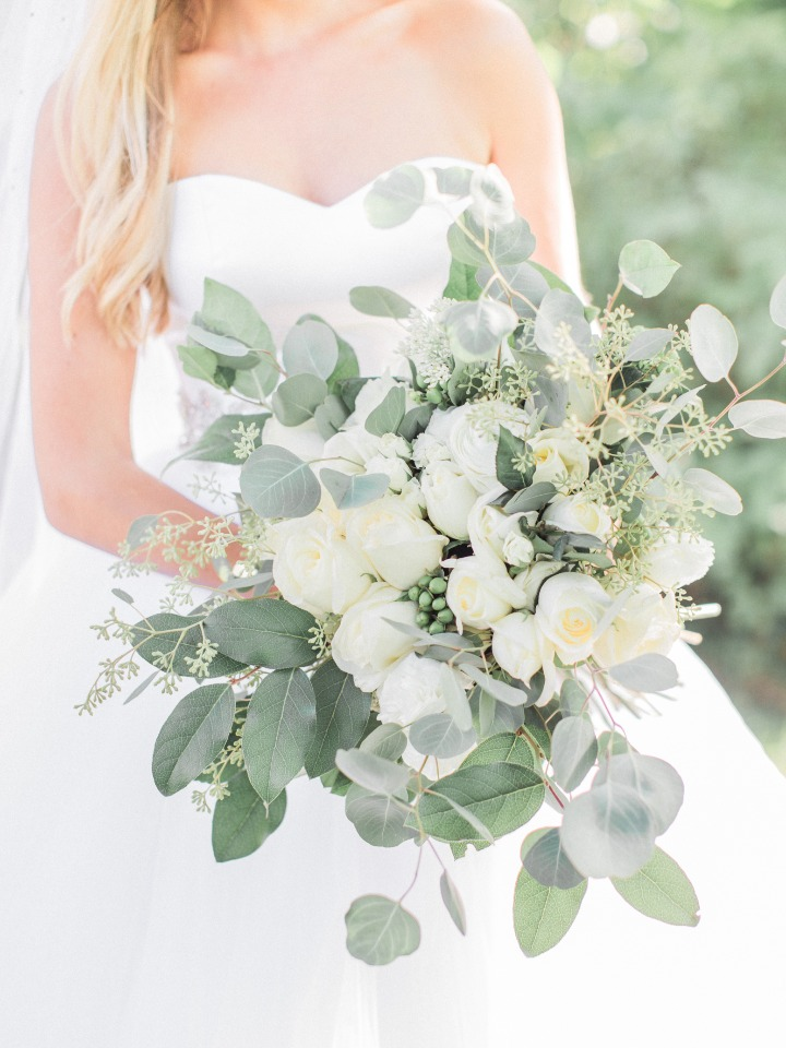 Overflowing bouquet with greenery and white roses