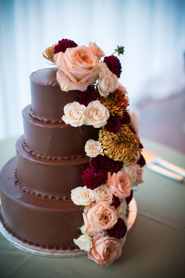 chocolate cake with flower garland topper