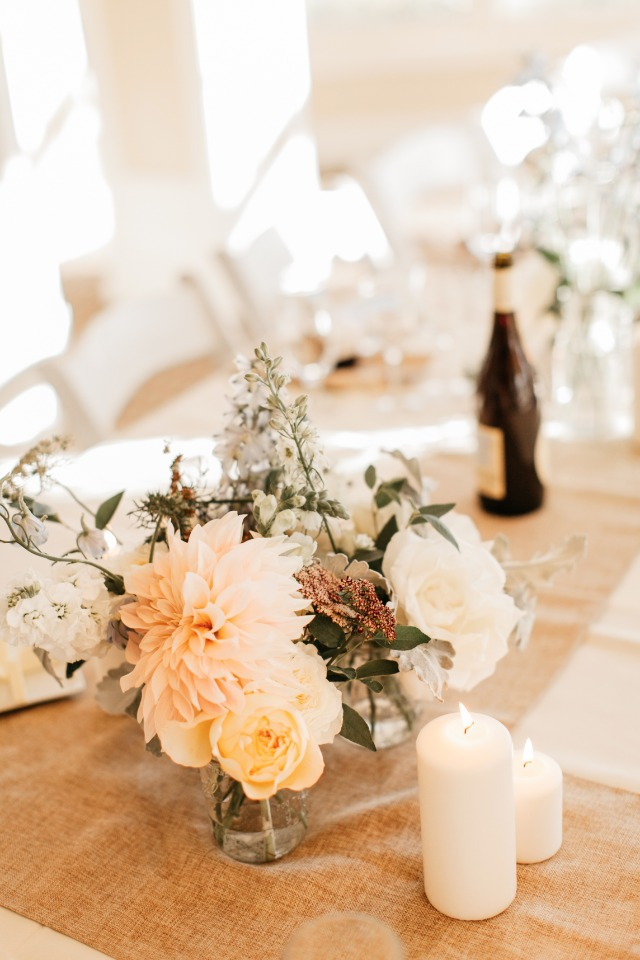 Pretty florals and simple white candles