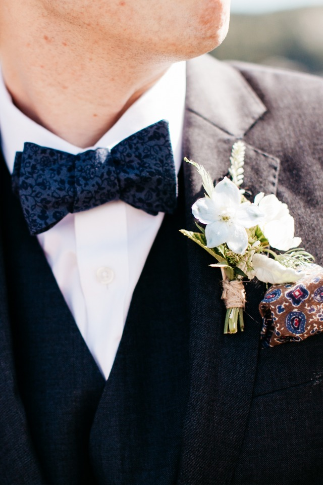Blue tie and white flower boutonniere
