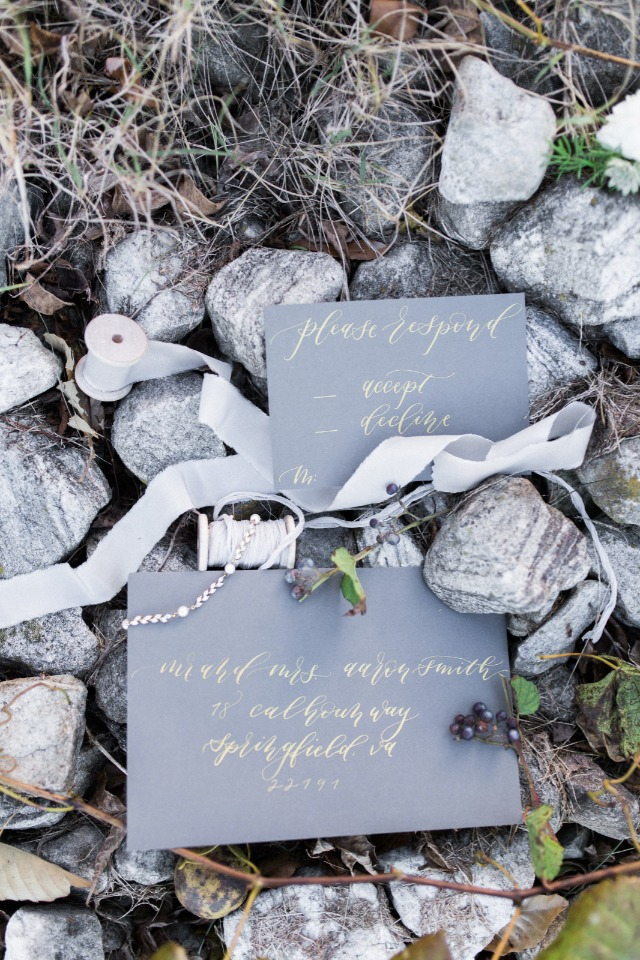 Dark invites with gold calligraphy