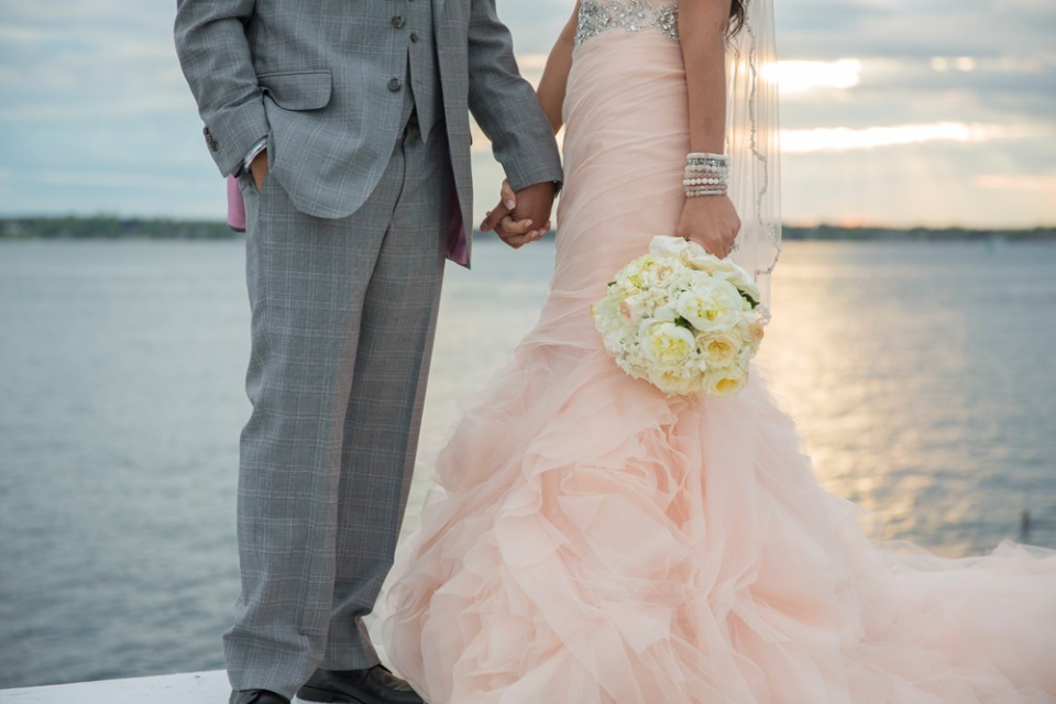 lovely blush wedding dress with some Bridal stacks from Sisco + Berluti