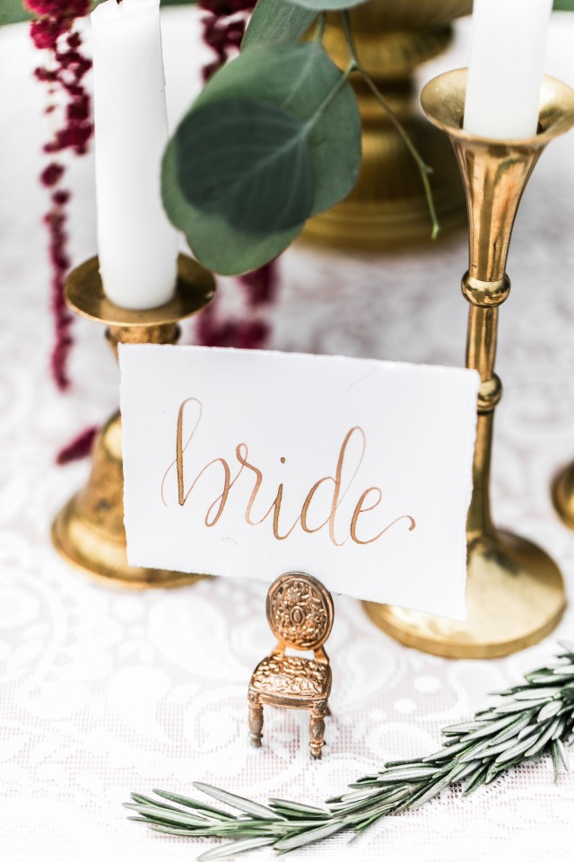 Gold calligraphy place card for the bride