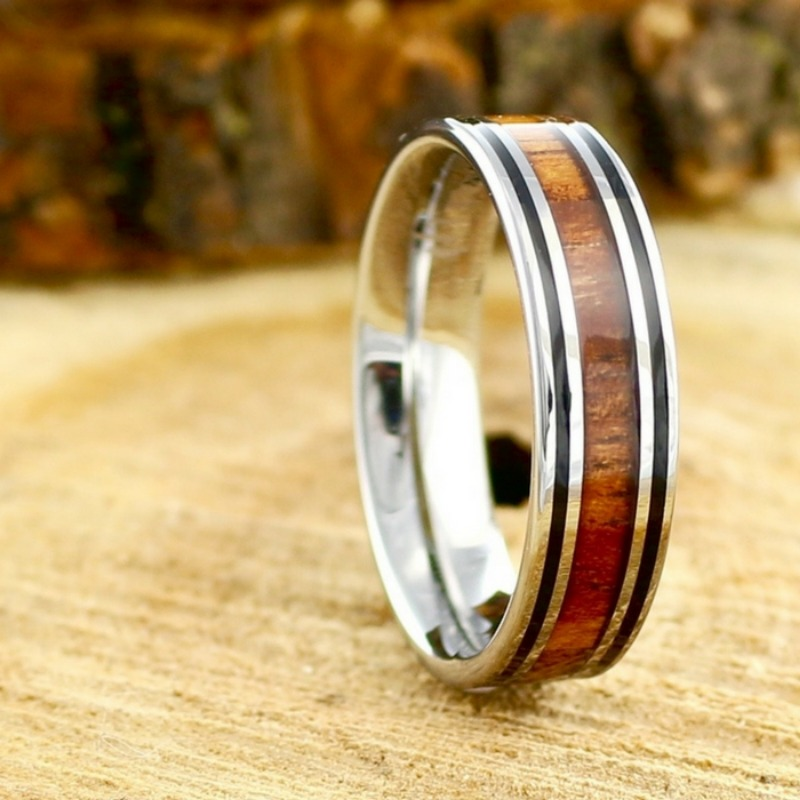Mens 6mm silver tungsten wedding band with genuine koa wood inlaid through the ceneter of the ring. This wood wedding band is 100%