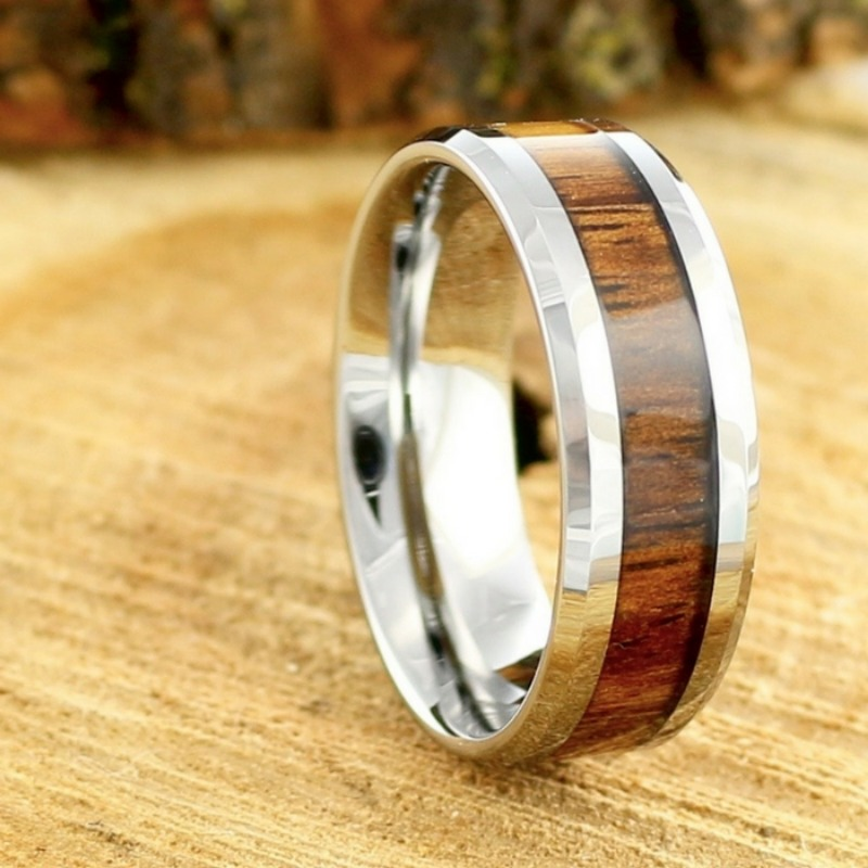 Mens 8mm silver tungsten wedding ring with polshied beveled edges and crafted with genuine koa wood running through the center of the