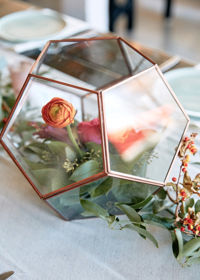 floral centerpiece in a terrarium