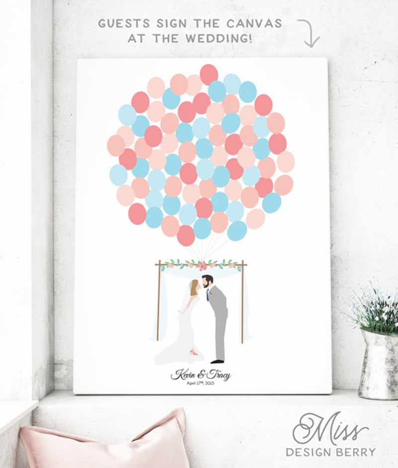 Miss Design Berry's fun wedding guest book alternative has a boho wedding theme and features a bride and groom portrait with balloons