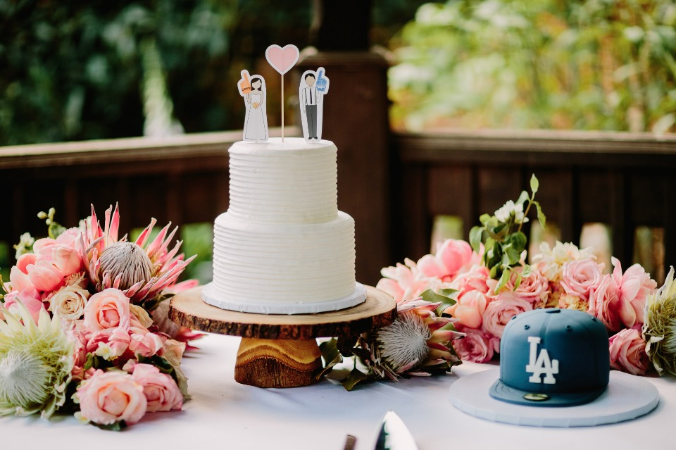Simple white cake and baseball hat grooms cake
