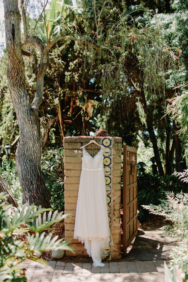 Summer wedding dress with flowy skirt and sparkly top