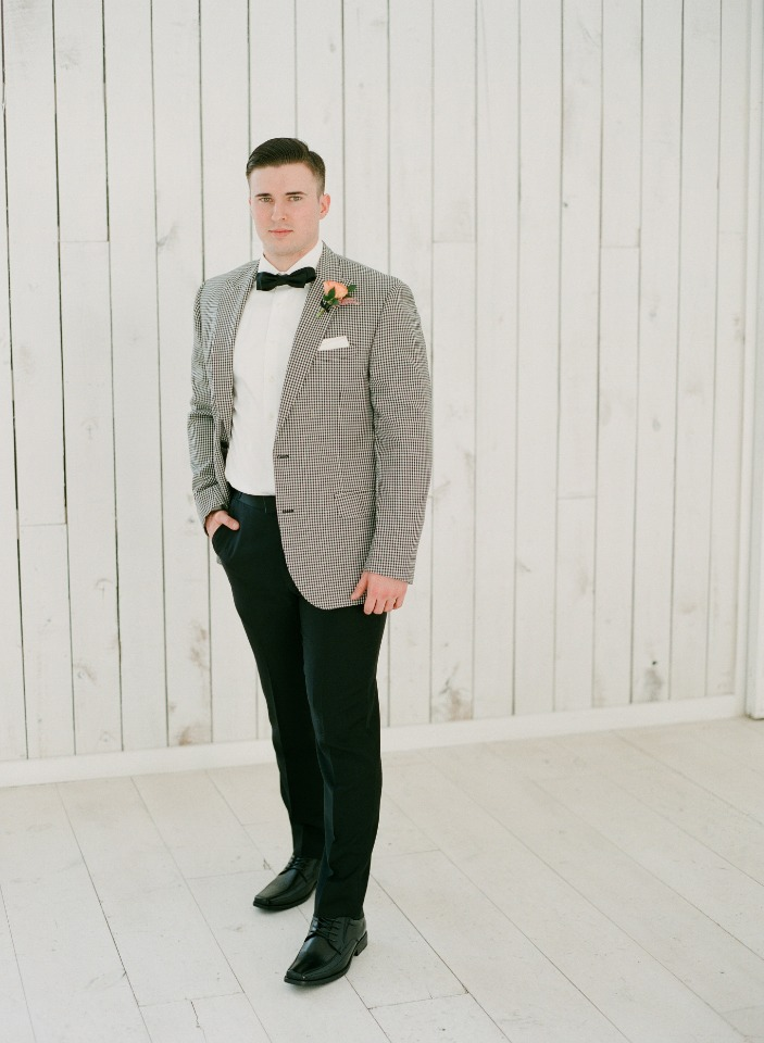 groom in vintage style checkered jacket