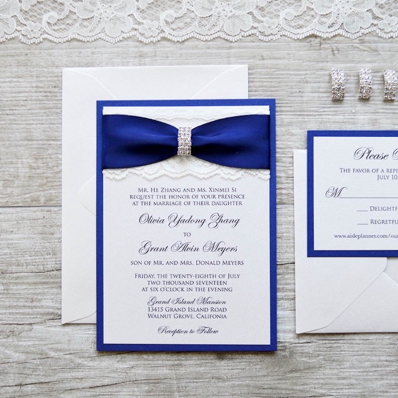 We've got the (happy) blues! What do you think about this elegant royal blue and ivory lace wedding invitation? Our fave is always