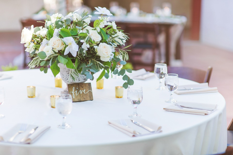 White and green centerpiece with wood table number