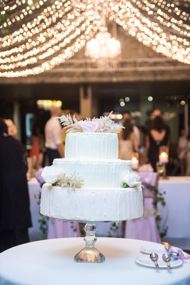 Pretty three tier white wedding cake