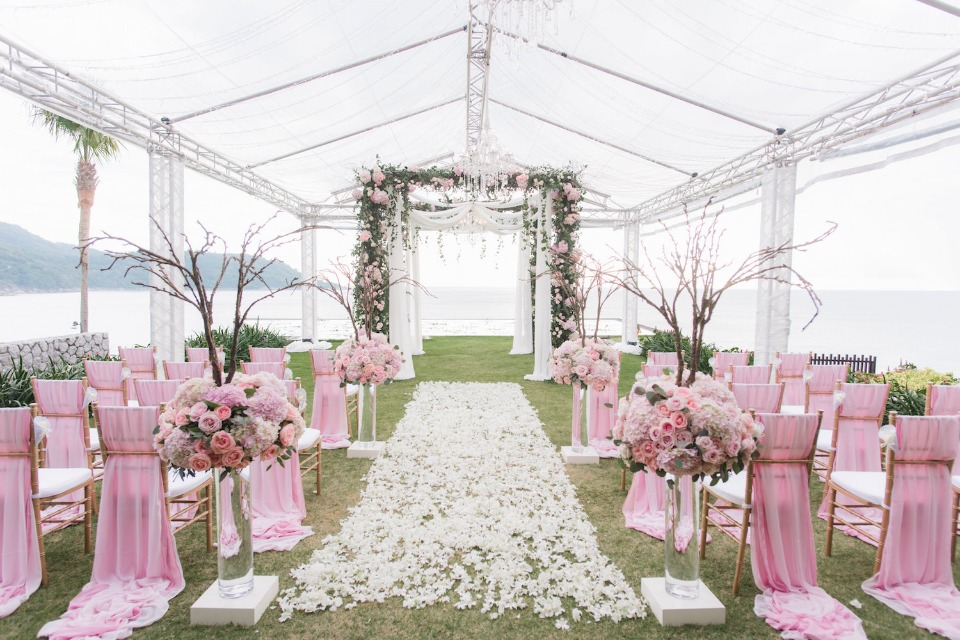 Pink and white wedding ceremony decor