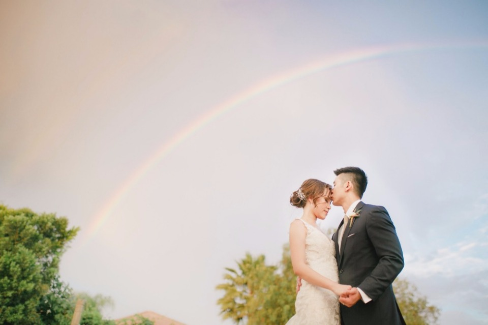How much more romantic could it get? Oh, well it got even mote romantic! This couple got a rainbow as their backdrop.