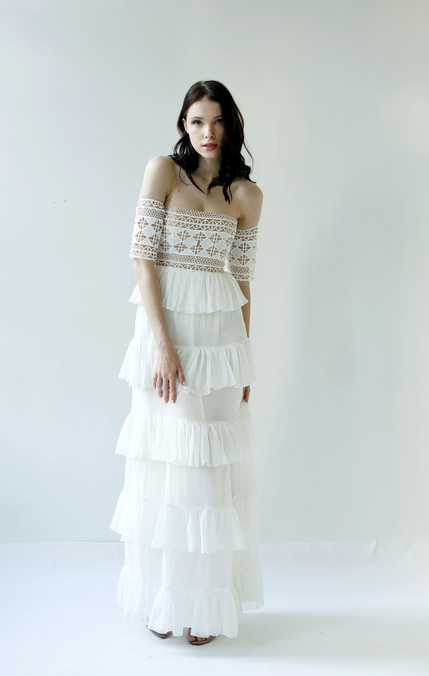 Off the shoulder Guipure lace wedding dress.