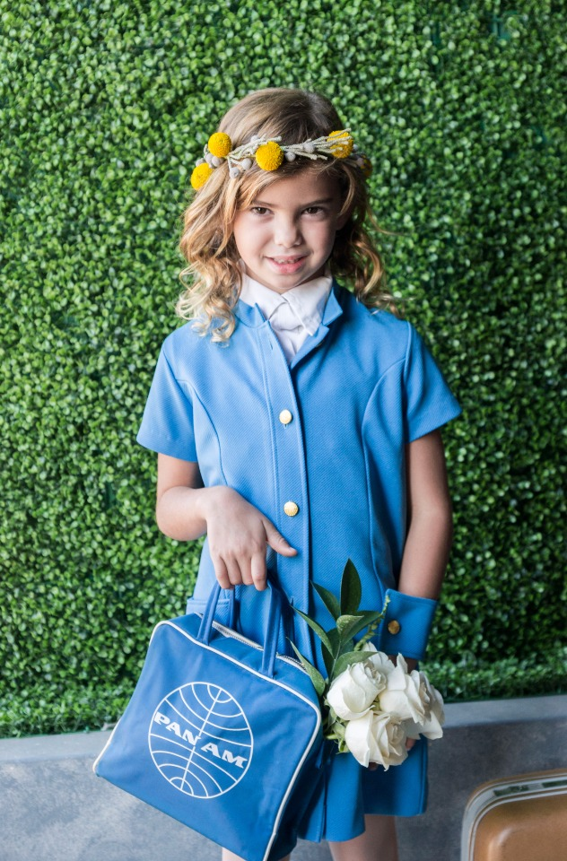 flower girl in vintage Pan Am uniform