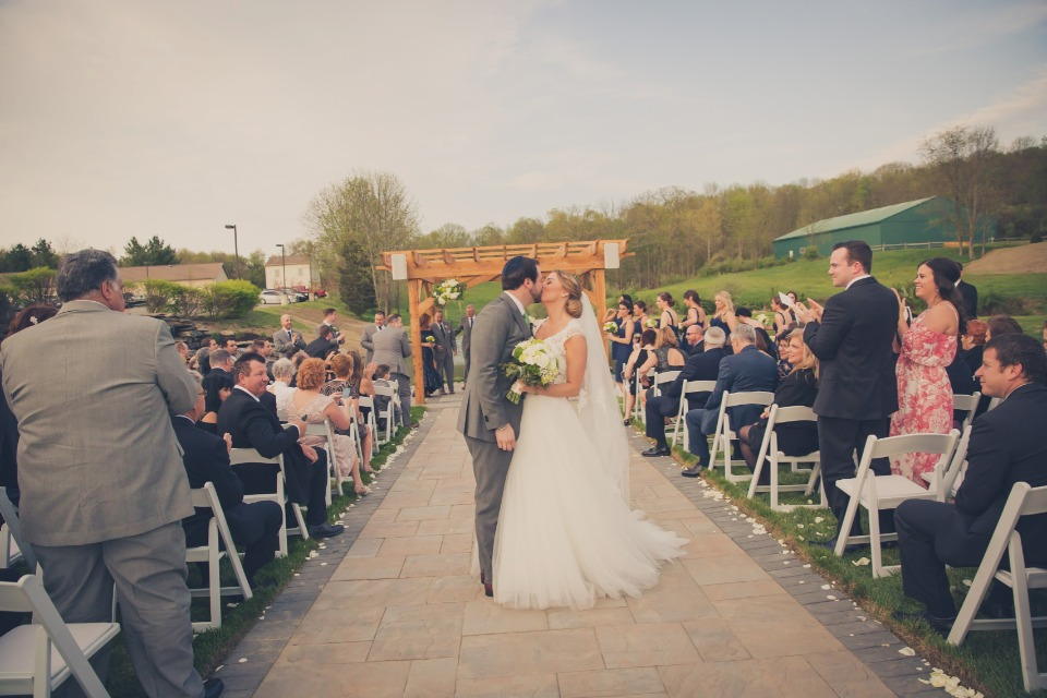 kissing the bride at Bear Brook Valley