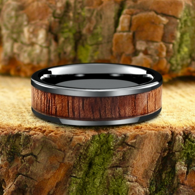 Mens wood wedding band crafted out of high tech ceramic and inlaid with 100% genuine koa wood. This ring is 100% waterproof and extremely