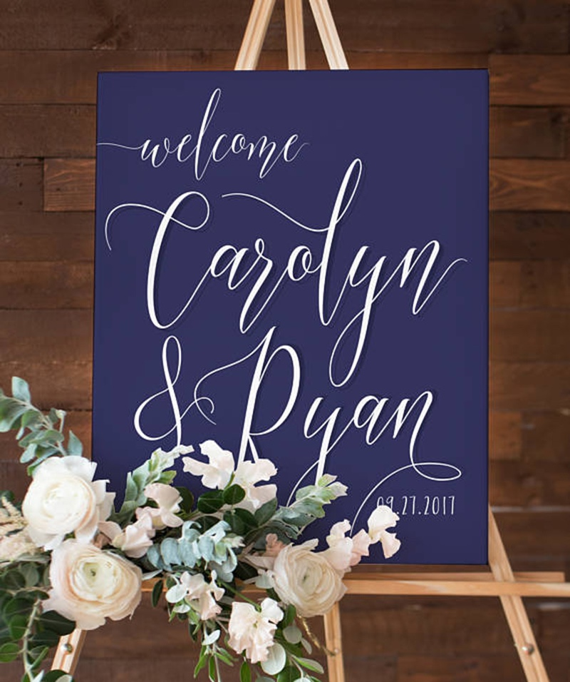 Miss Design Berry's navy and white wedding welcome sign features dynamic type for an elegant yet modern look, perfect for your navy