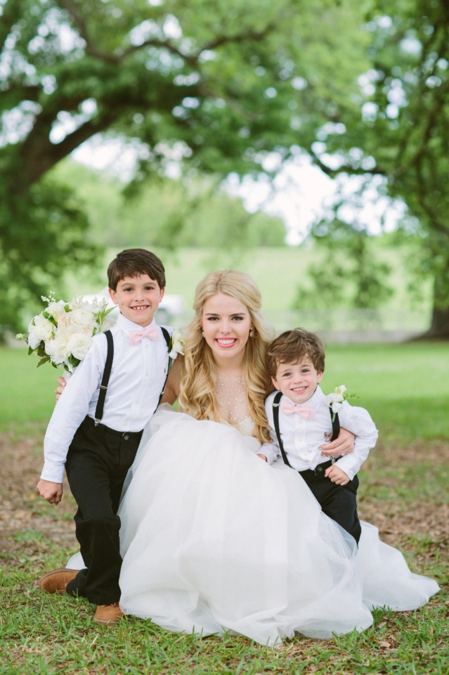 ring bearers in suspenders and pink bow ties