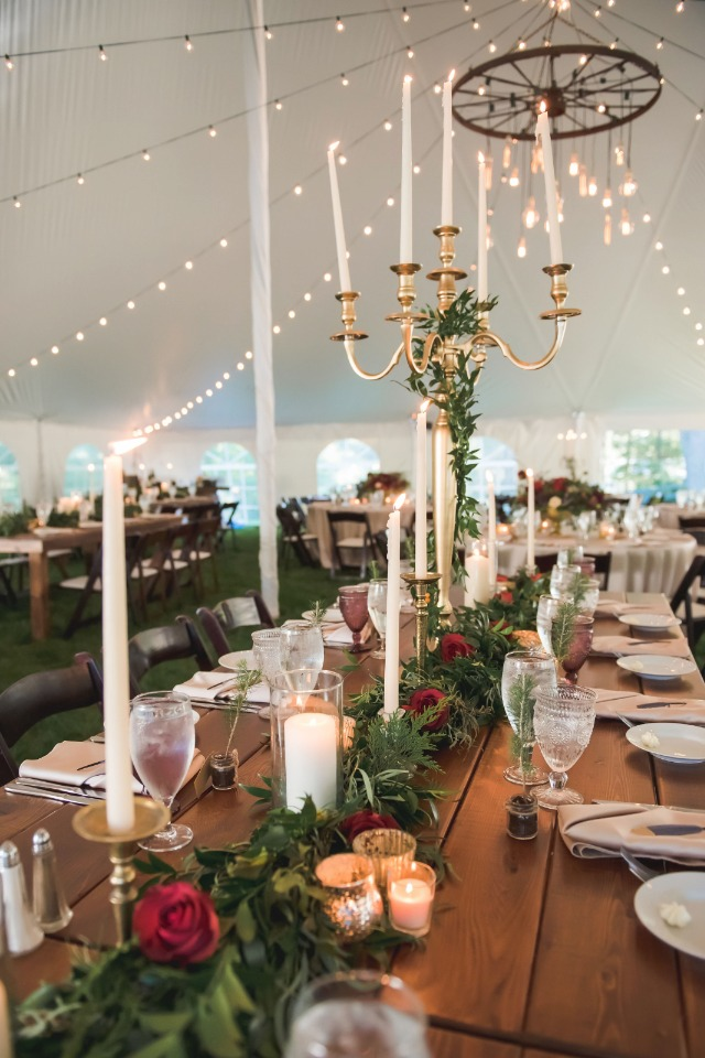Greenery and varying candle holders make an eye catching statement
