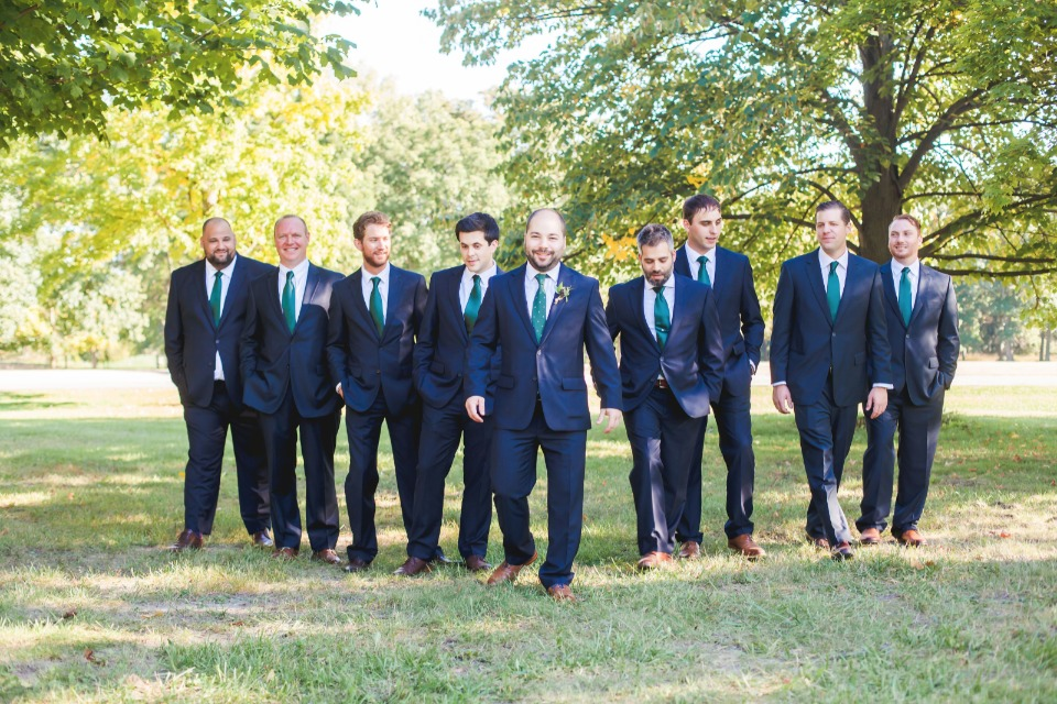 Navy suits and teal ties