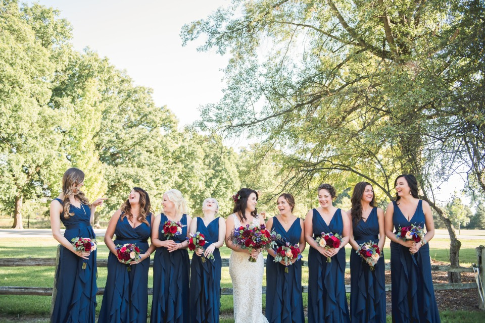 Blue dress and red bouquets are gorgeous